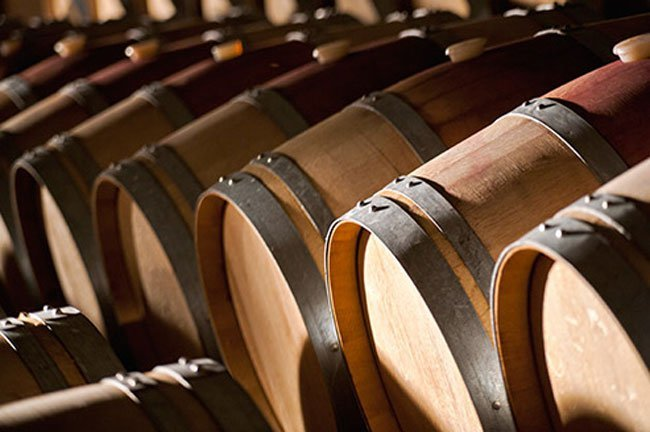 Aging wine in oak barrels slowly adds oxygen to the wine and pleasant flavors from the wood.