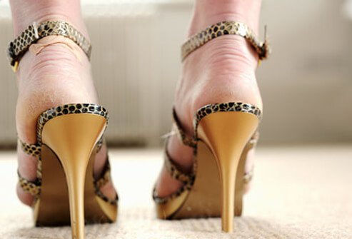 Photo of woman in pointy heels that are the wrong size.