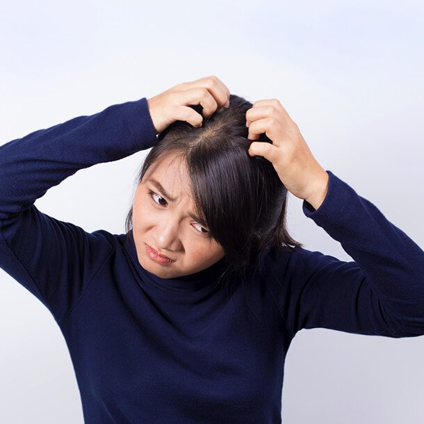 Getting rid of an itchy scalp depends on the cause, which can include dandruff, allergic reaction, hives, scabies, head lice, psoriasis, ringworm, atopic dermatitis, nerve problems, and skin cancer. Treatment may involve over-the-counter (OTC) shampoos, medicated shampoos, prescription cream, antifungal medications, and others.