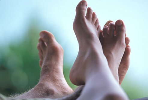 Photo of peoples feet.